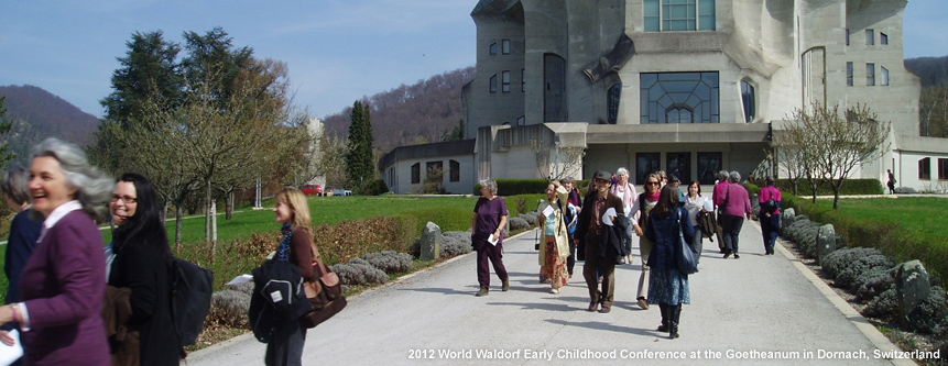 In Dornach, Switzerland, a group of adults exit the Goetheanum, during the 2012 Waldorf World Early Childhood Conference.