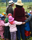 An early childhood class goes for a walk at Sunrise Waldorf School, Canada.The sidebar directs us to learn about W.E.C.A.N. membership.